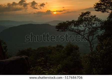 sun rising early morning with the mist and forest mountain and clouds at the north of Thailand