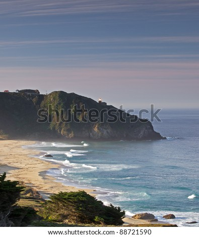 sun rising over the point sur light station on a foggy fall morning,big sur coast,central california - stock photo