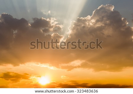 Sun's rays breaking through trough the clouds - stock photo