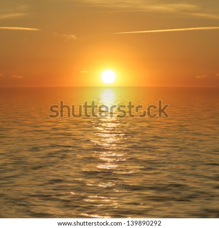 sun set behind the sea - stock photo