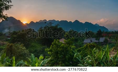 Sun set in Vang Vieng, Laos - stock photo