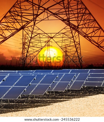 sun set with structure of high voltage electric power tower and solar cell panel in energy farm  - stock photo