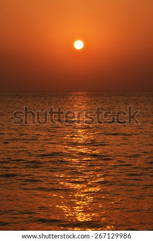 Sun setting at the beach - stock photo
