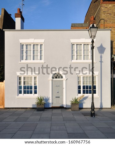Sun setting on old townhouse along pedestrian mall in London, UK - stock photo