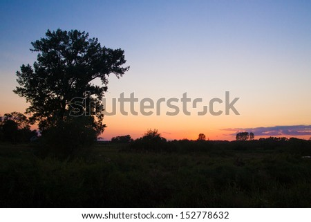 Sun setting over Biebrza reserve - stock photo