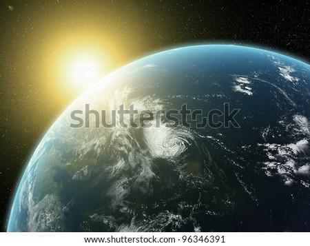 Sun setting over Earth - stock photo