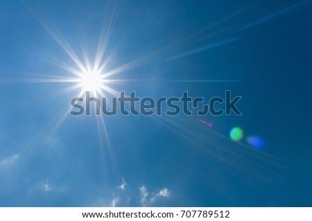 Sun shines in sky amid beautiful clouds. Concept is lighting of life. & Blue Sky Bright Sunshine Light Beam Stock Photo 674657197 ... azcodes.com