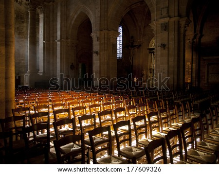 Sun shines inside an empty church in France - stock photo