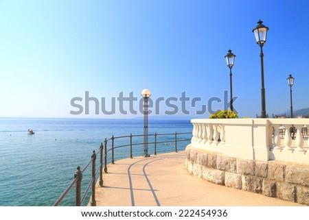 Sun shining on wide promenade near the Adriatic sea, Opatija, Croatia - stock photo