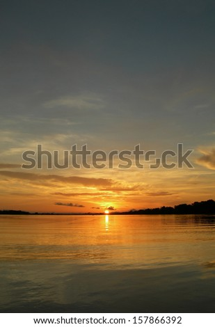 Sun, sky and waters on the Rio Negro in the Amazon River basin, Brazil, South America           - stock photo