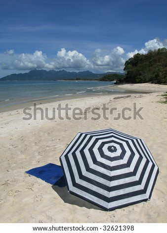Sun umbrella on a sandy beach of Langkawi island Malyasia - stock photo