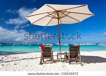 Sun umbrella with Santa Claus Hat on chair longue