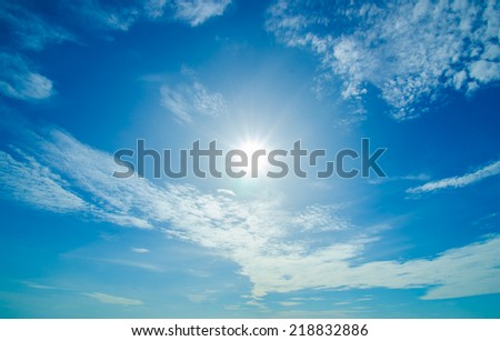 Sun with blue skies and cloud - stock photo