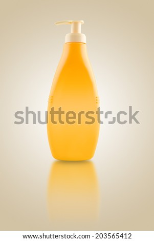 Sunbath oil or sunscreen bottle. Blank yellow plastic bottle. - stock photo