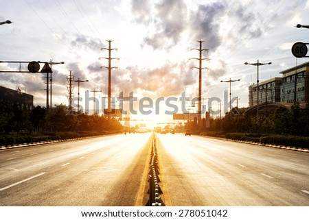 sunbeam on the urban road  - stock photo