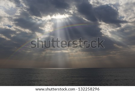 sunbeam over the rainbow - stock photo