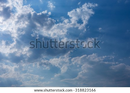 sunbeam through the clouds of sunlight in blue sky background - stock photo