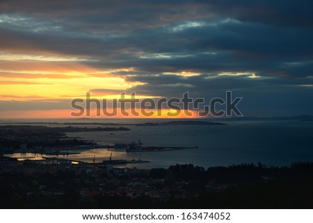 Sunbeams on the background of the ocean and the storm cloud - stock photo