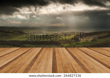 Sunbeams over Big Moor in Peak District National Park in Autumn with wooden planks floor - stock photo