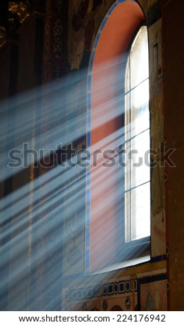 Sunbeams passing through window in Armenian church of Lviv with cold tones - stock photo
