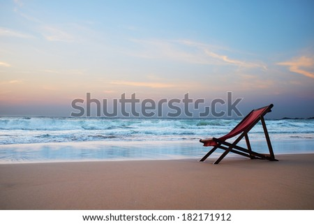 Sunbed on the beach at sunset  - stock photo