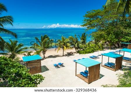 Sunbed on tropical beach - stock photo