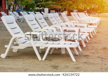 sunbed or chair on the tropical beach. - stock photo
