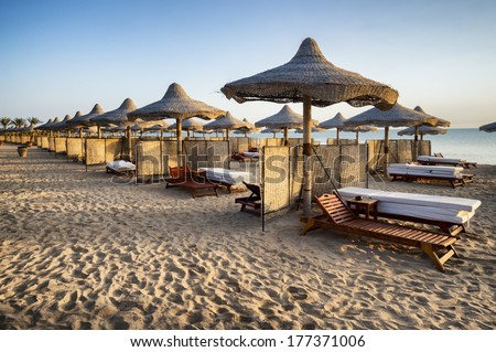 sunbeds and beach umbrella in Marsa Alam, Egypt