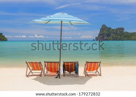 Sunbeds and umbrella at beautiful bay of Phi Phi island at day time, Thailand