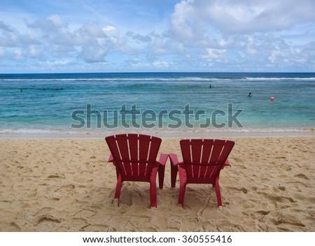 Sunbeds in the beach, relax near sea, Guam island