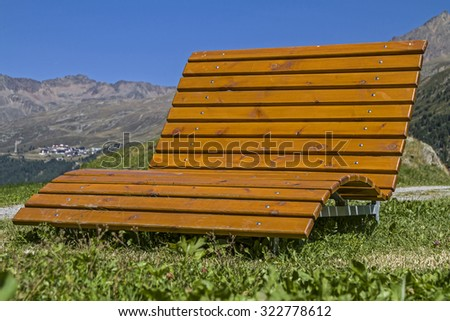 Sunbeds invites you to relax and enjoy  - stock photo