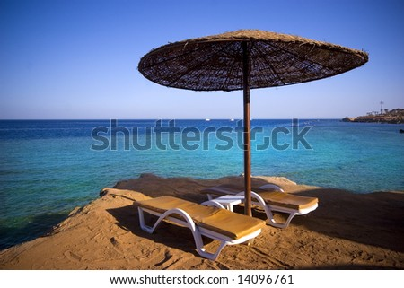 Sunbeds on the beach - stock photo