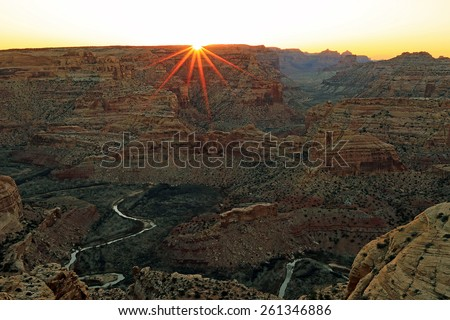Sunburst in the Utah desert, USA. - stock photo