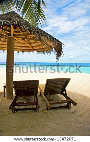 sunchairs and umbrellas in a tropical beach