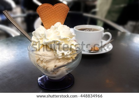 sundae with ice cream, whipped cream and biscuit in heart shape and a ...