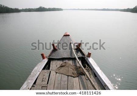 SUNDARBANS, INDIA - JANUARY 15: Boat trip in the Sundarbans January 15, 2009 in Sundarbans, West Bengal, India - stock photo
