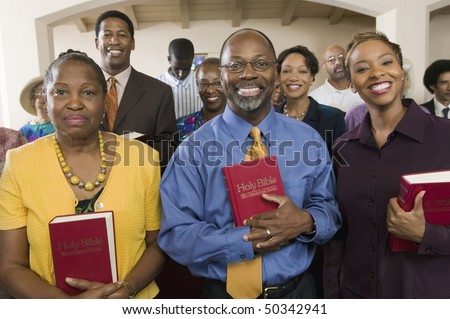 Sunday Service Congregation standing in church with Bibles, portrait - stock photo