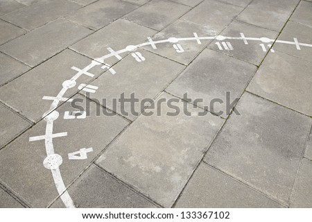 Sundial classic, detail of ancient sundial painted on the floor, old instrument - stock photo