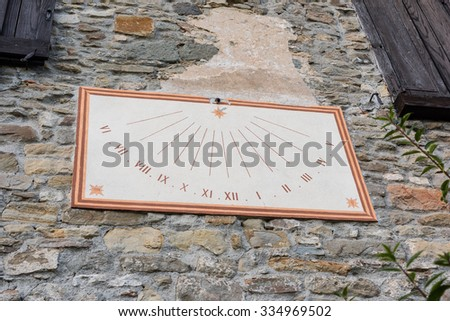 Sundial on the wall - stock photo