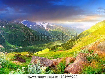 Sundown in large mountain valley. Natural summer landscape - stock photo