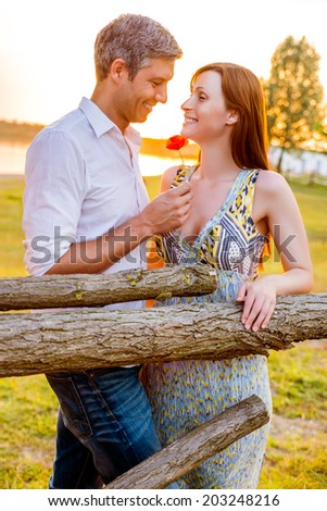 sundown sea coast couple in countryside scenic romantic situation - stock photo