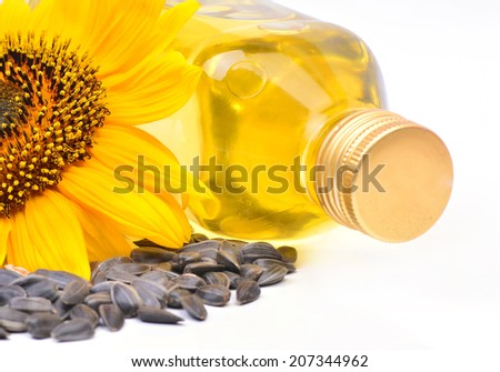 Sunflower and oil on a white background