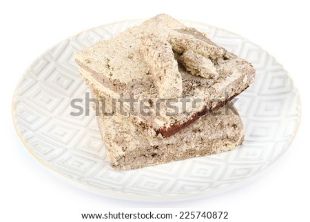Sunflower halva with cocoa on plate isolated on white background