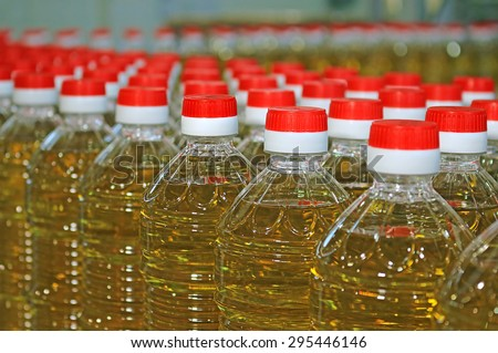 Sunflower oil in the bottle moving on production line - stock photo