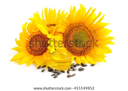 Sunflower oil with flowers and by seed on white background - stock photo