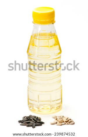 Sunflower seed with and without husk oil bottle on white background - stock photo