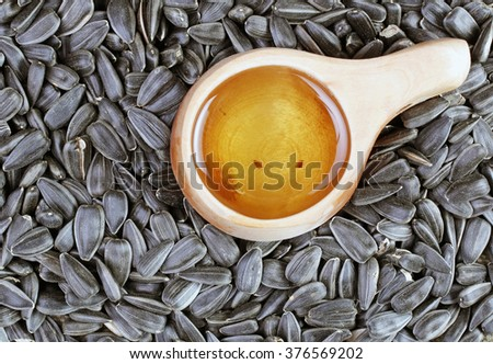 sunflower seeds and oill - stock photo