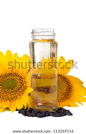 Sunflower seeds and vegetable oil in a bottle isolated - stock photo