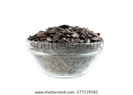 Sunflower seeds in a bowl - stock photo