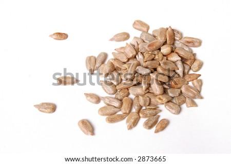 Sunflower seeds isolated on white. - stock photo